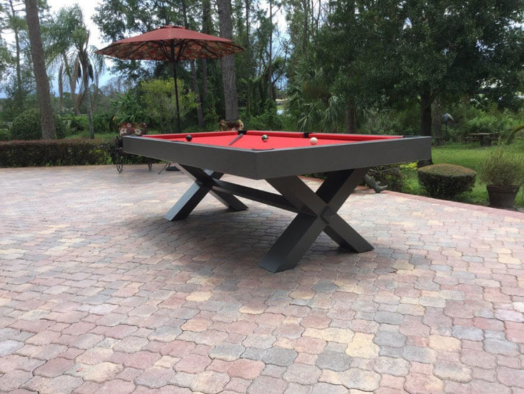 red and black x-air outdoor pool table setup
